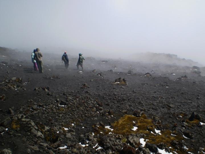 The upper slopes of mount Karisimbi in Rwanda with black volcanic soil